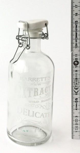 Bügelflasche H 15,5 cm Glas Schrift: Extract Delicate Porzellandeckel weiß